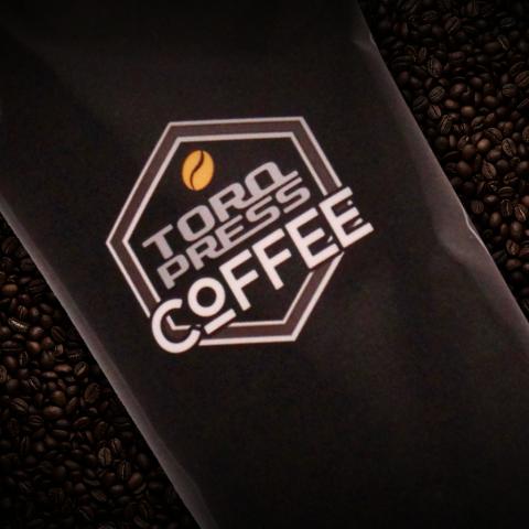 Caramel Latte TORQ Press Coffee Logo